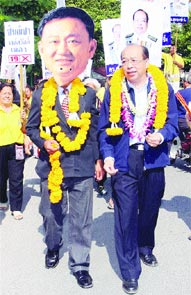 From The Nation:  Surapong Towijakchaikul, right, a candidate for the People Power Party in Chiang Mai, walks with a supporter wearing a mask of former prime minister Thaksin Shinawatra during […]