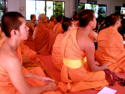 Monks listening intently