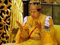 Malaysia's Sultan Sharafuddin Idris Shah recites a prayer after being coronated as the new Sultan of..