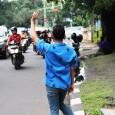 Mariam Koslay takes a close-up look at the experiences of Jakarta's traffic jockeys