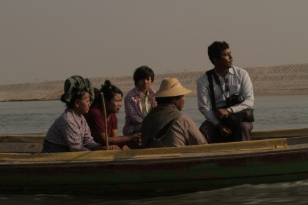 Myint Zaw (right) travels along the Irrawaddy river. Photo courtesy of Goldman Environmental Prize.