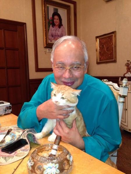 Najib Razak with cat and cigar