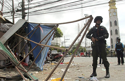 Thai soldiers and police officers at the scene of a bomb attack in Pattani province, southern Thailand Photo: EPA.