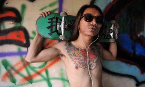 A Burmese skater posing with his board at Nanat Taw Bridge in Yangon. Photo by Ye Aung Thu/ AFP.