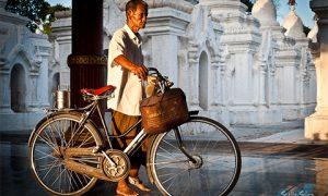 Man with his bike. Photo by Staffan Scherz on flickr.