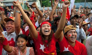 National League for Democracy (NLD) supporters celebrate their victory in parliamentary elections outside party headquarters on April 1, 2012 in Yangon, Myanmar. Photo by Paula Bronstein/Getty Images.