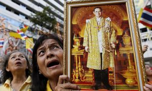 Thai royalist holds a portrait of King Bhumibol Adulyadej. Photo by EPA/ Rungroj Yongrit.
