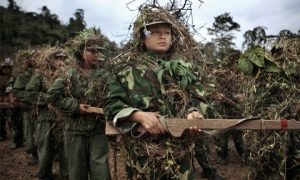 Kachin Independence Army (KIA) and civilian militia trainees xxx during a three month basic military training course on a base near Laiza in KIA controlled territory of Kachin State, Myanmar on Jan. 4, 2012.