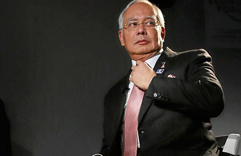 DAVOS/SWITZERLAND, 25JAN13 - Mohd Najib Bin Tun Abdul Razak, Prime Minister and Minister of Finance of Malaysia adjusts his tie before the session 'An insight, an idea' at the Annual Meeting 2013 of the World Economic Forum in Davos, Switzerland, January 25, 2013.   Copyright by World Economic Forum  swiss-image.ch/Photo Mirko Ries