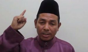 Abdul Karim Khalib of the Barisan Revolusi Nasional (BRN) rebel group criticizes Thai тАЬcolonialismтАЭ in a six-minute video posted online 7 September. Photo from YouTube.