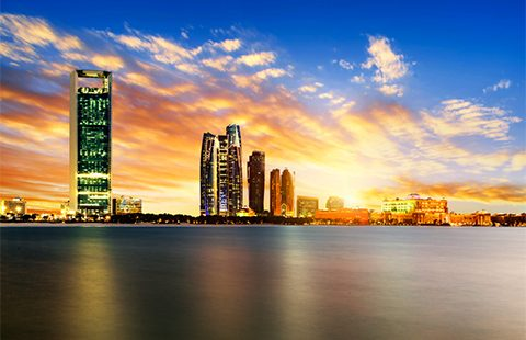 Panorama of Abu Dhabi at night, capital of United Arab Emirates