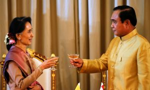 Myanmar Foreign Minister and State Counselor Aung San Suu Kyi toasts with Thai Prime Minister Prayuth Chan-ocha during an MoU ceremony at the government house in Bangkok