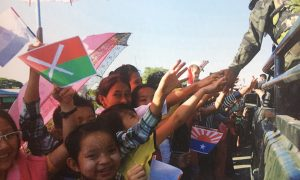 Children clutch ethnic flags as soldiers arrive in Kachin State, 2013. Photo: 'Boothee' Thaik Htun.