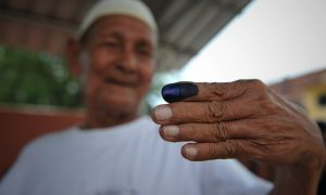 Indelible ink being applied to a voters finger after cast their vote during Malaysia General Election in Kuala Lumpur