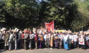 A photograph of demonstrators supporting Daw Aung Suu Kyi